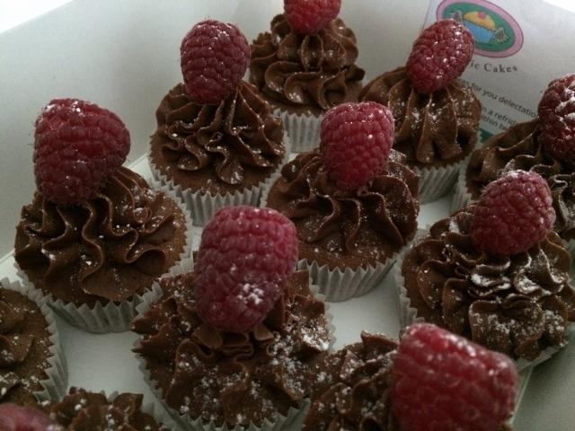 mini-chocolate-cupcakes-with-ganache-and-raspberry-topping-001.jpg